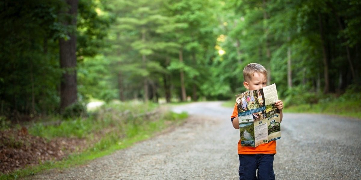 Boy holding a map